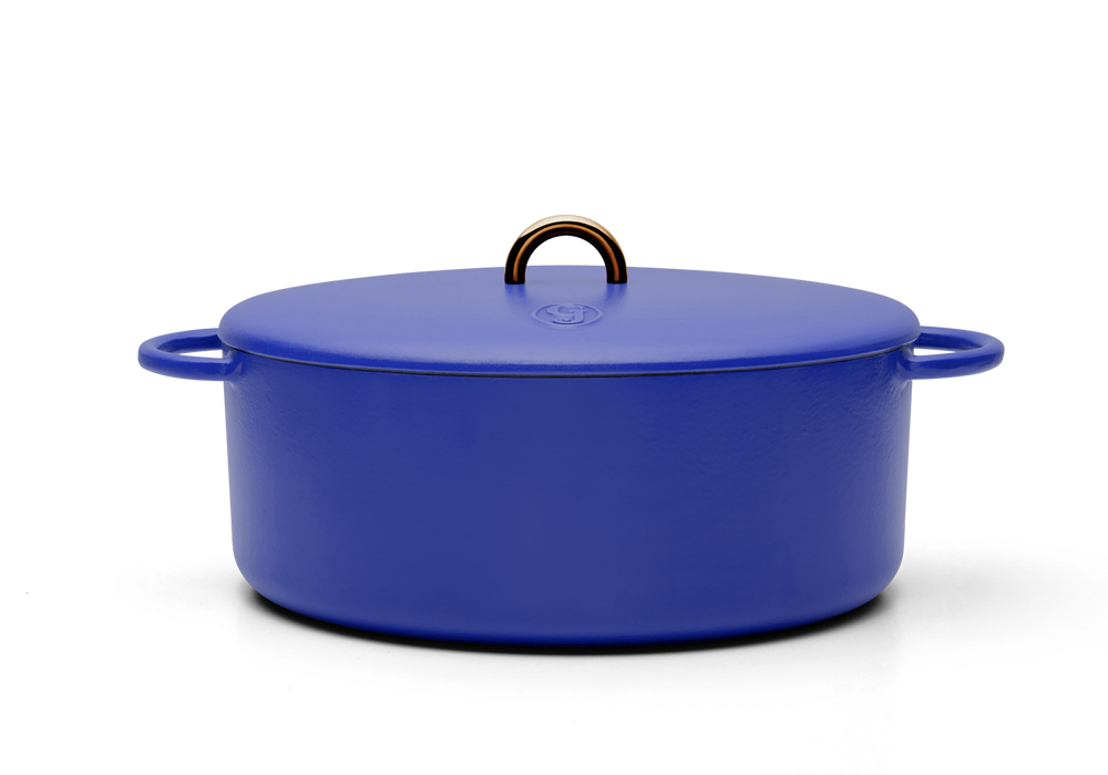 Enameled cast-iron Dutch oven in blueberry blue - side view with lid