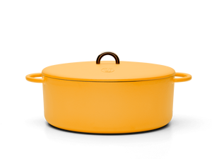Enameled cast-iron Dutch oven in mustard yellow - side view with lid