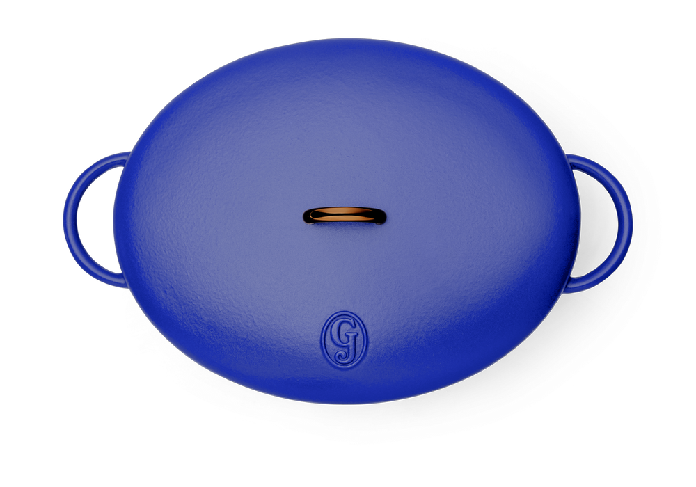 Enameled cast-iron Dutch oven in blueberry blue - top down view with lid