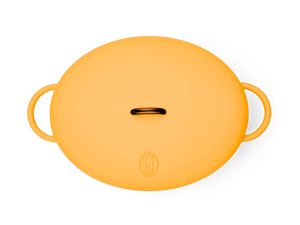 Enameled cast-iron Dutch oven in mustard yellow - top down view with lid
