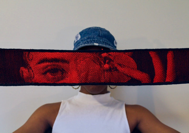 Photo montage of artist Favielle wearing a jeans baseball cap, with a large band of a woman in a red light cutting the picture in half
