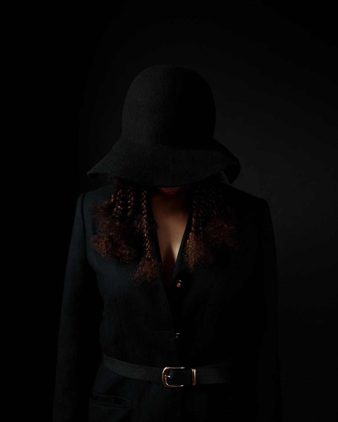 Editorial photo of the Camille Côté Cropped Hat on a model in the dark