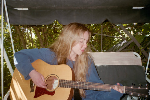 Lennie Rayen playing guitar is our artist of the week