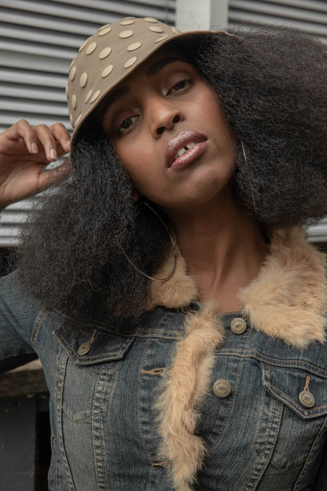 Nicole Musoni for our 2020 spring editorial wearing a unique Camille Côté felt hat in a vintage jeans jacket.