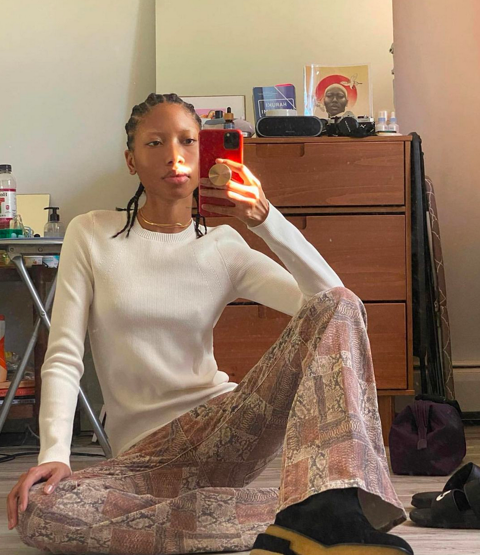 Curly hair model taking a selfie with lounge clothes, taking off @addictedtodom Instagram account