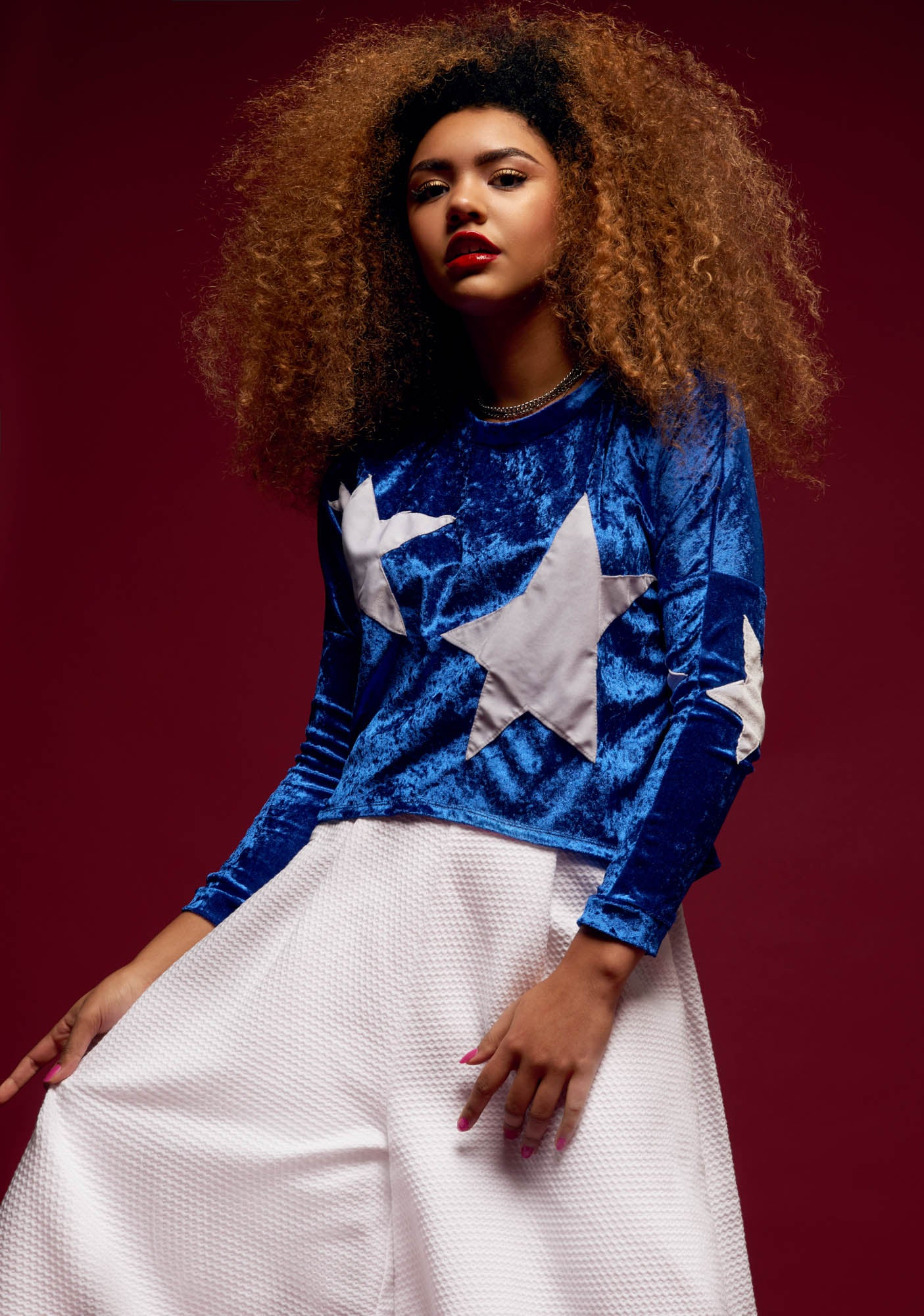 The afro hair model wears a fashion outfit for Camille Côté.