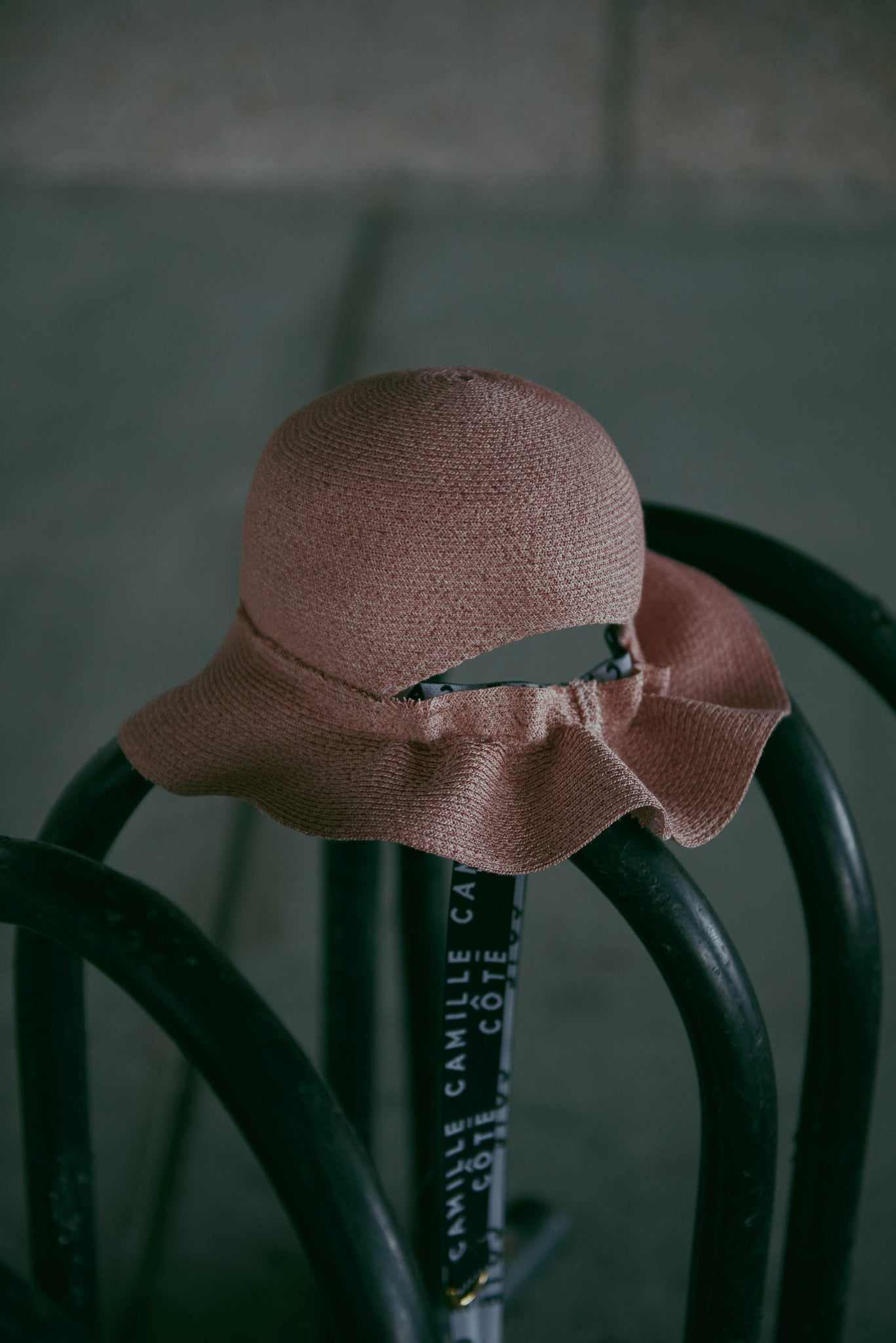 On the street, the pink bucket hat liberty matching the Camille Côté belt.