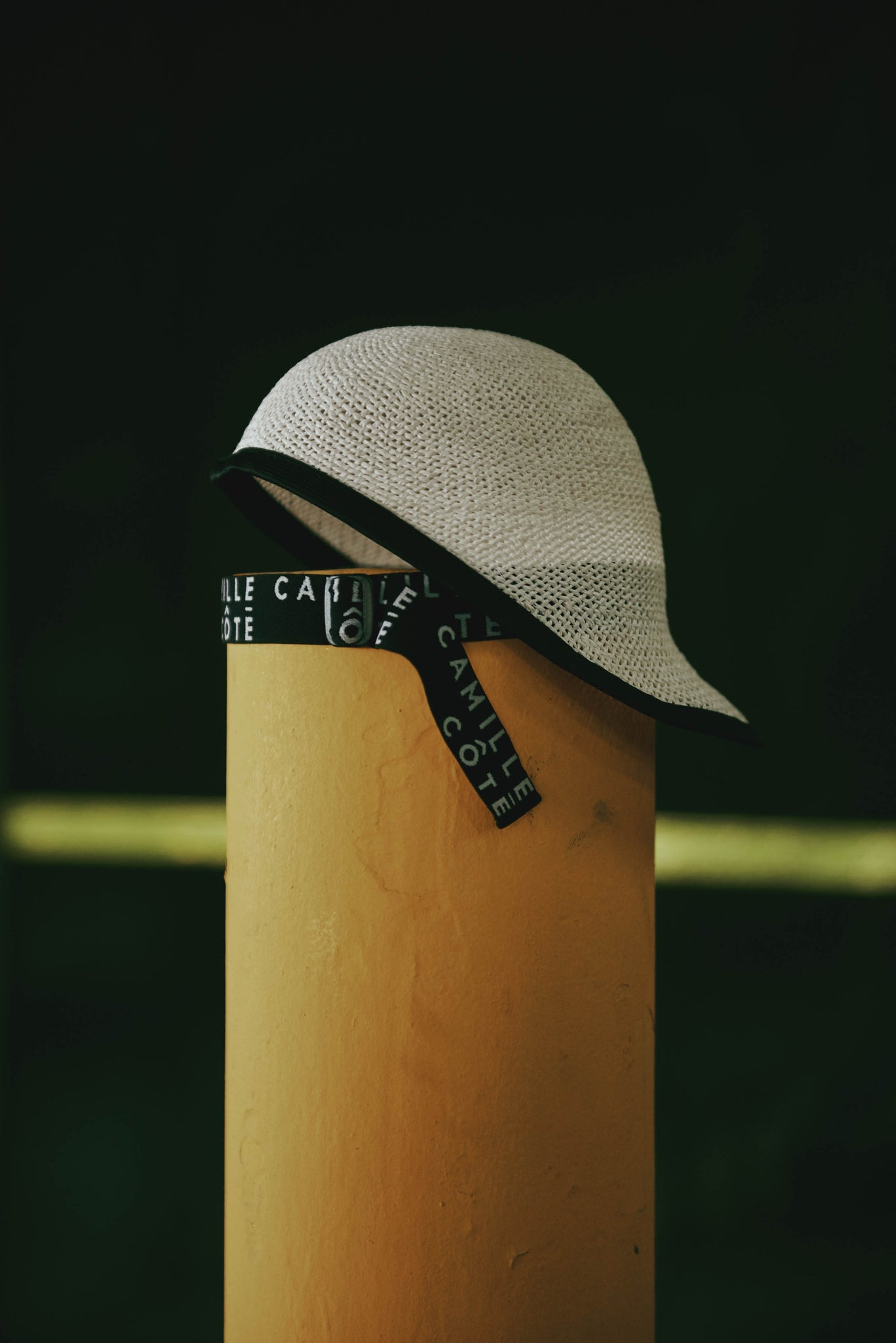 In the street there is the Claire white straw riding cap with Camille Côté logo on it.
