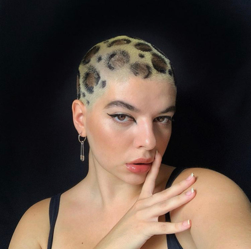 Short haired model with a leopard buzzcut