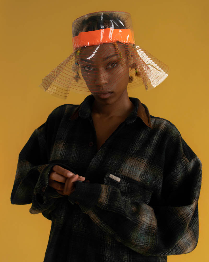 The singer Shah Frank wearing the clear and orange bucket hat for Camille Côté.