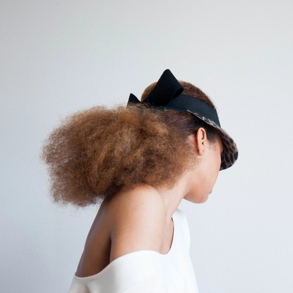 The carter visor is designed for big hair.