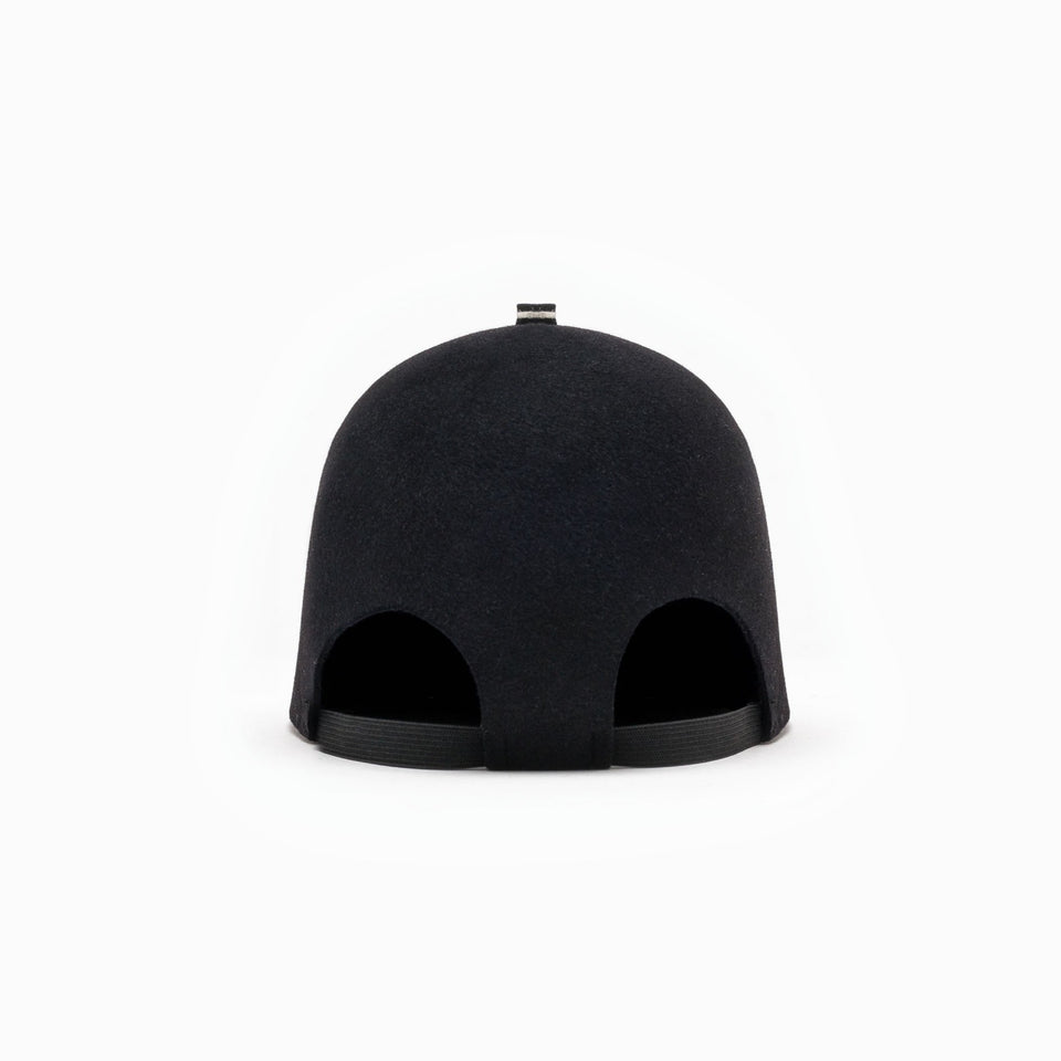 The GUERRERO Cropped Cap™ view from the back has an elastic band designed.