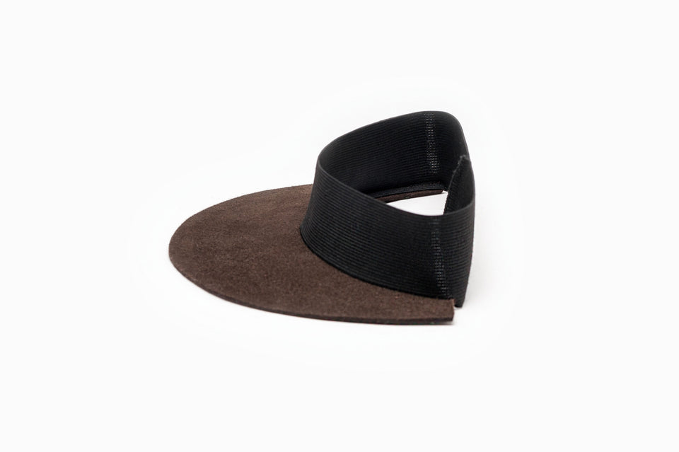 Side view of a brown felt visor from Camille Côté's collection.