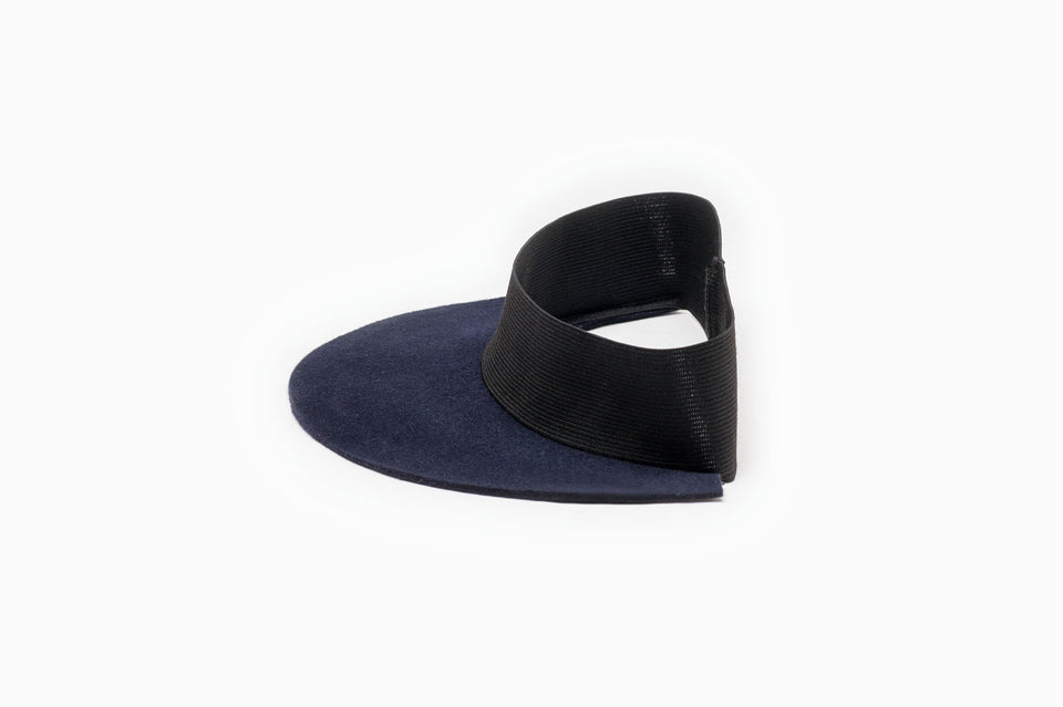 Side view of a navy felt visor available on Camille Côté store.