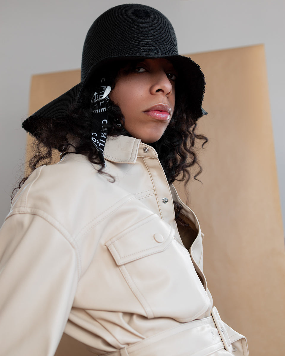 The model wear a 70's styled jacket with the KITT straw hat form Camille Côté shop