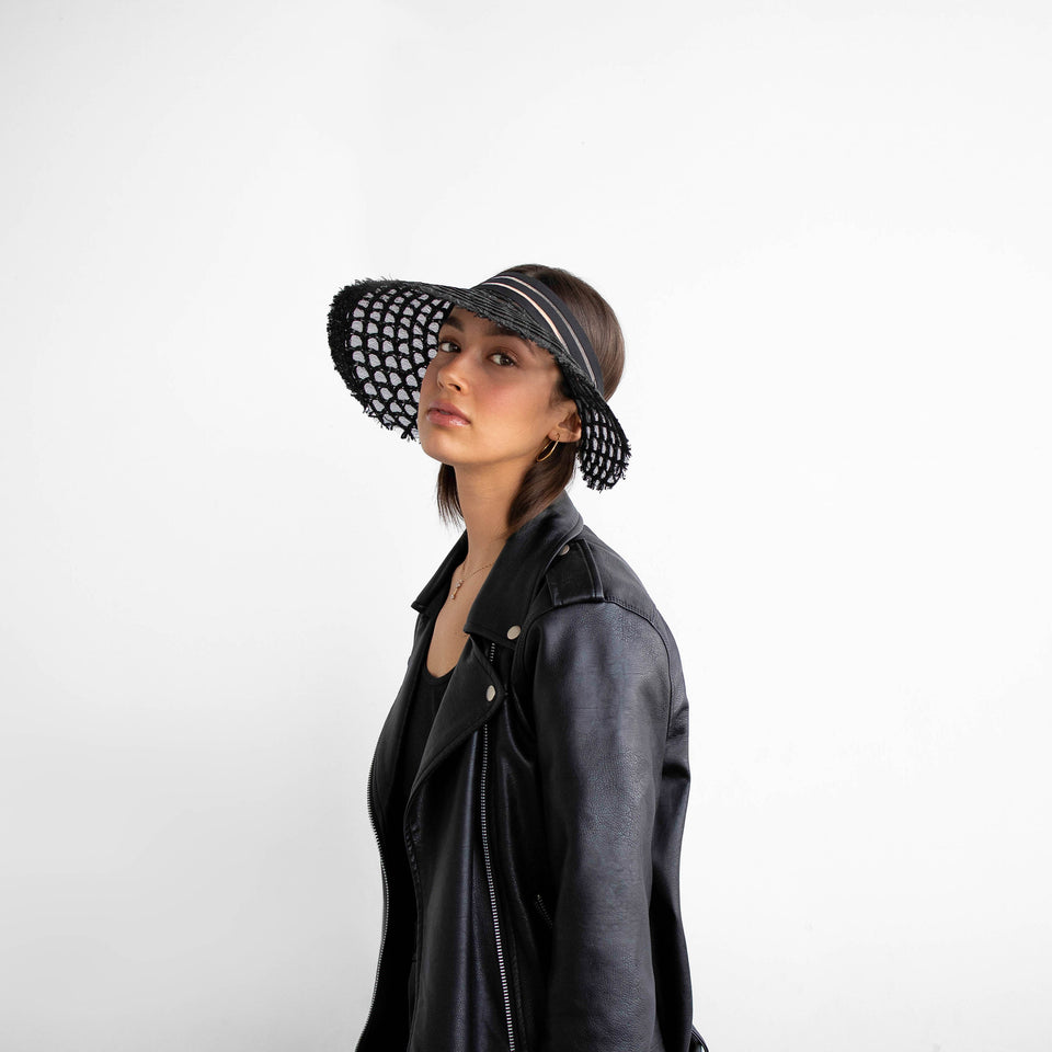 The AIMÉE hat, weared by the model,  is the perfect visor for summer