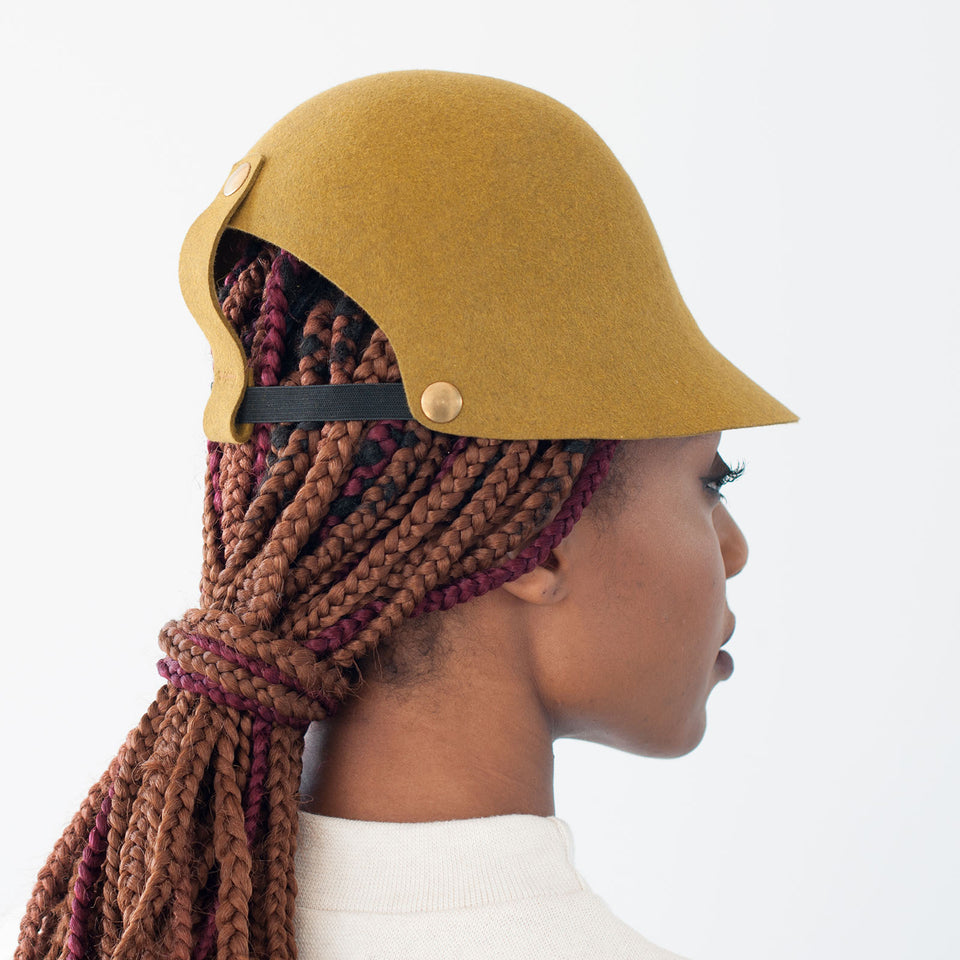 The model is wearing the felt gold hat ALI, from FW17 collection