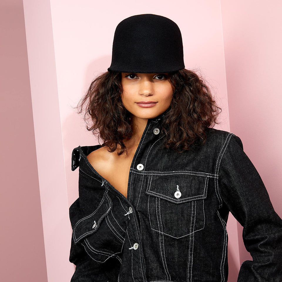 The elegant black felt hat BIGGIE weared by the model, from designer Camille Côté.