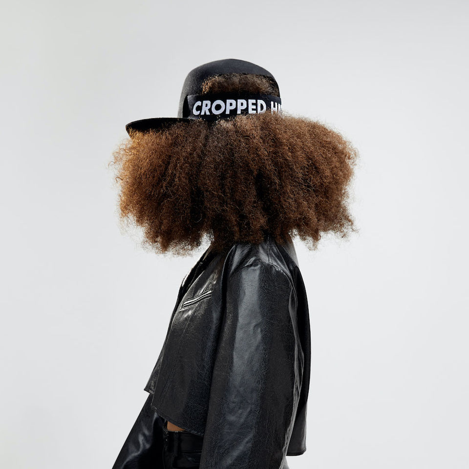 The Cropped Hat™ weared by an afro hair model.