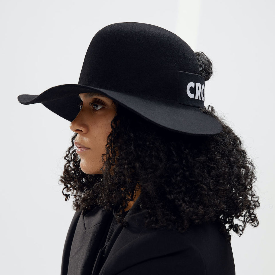The curly natural hair model wearing Camille Côté Cropped Hat™.