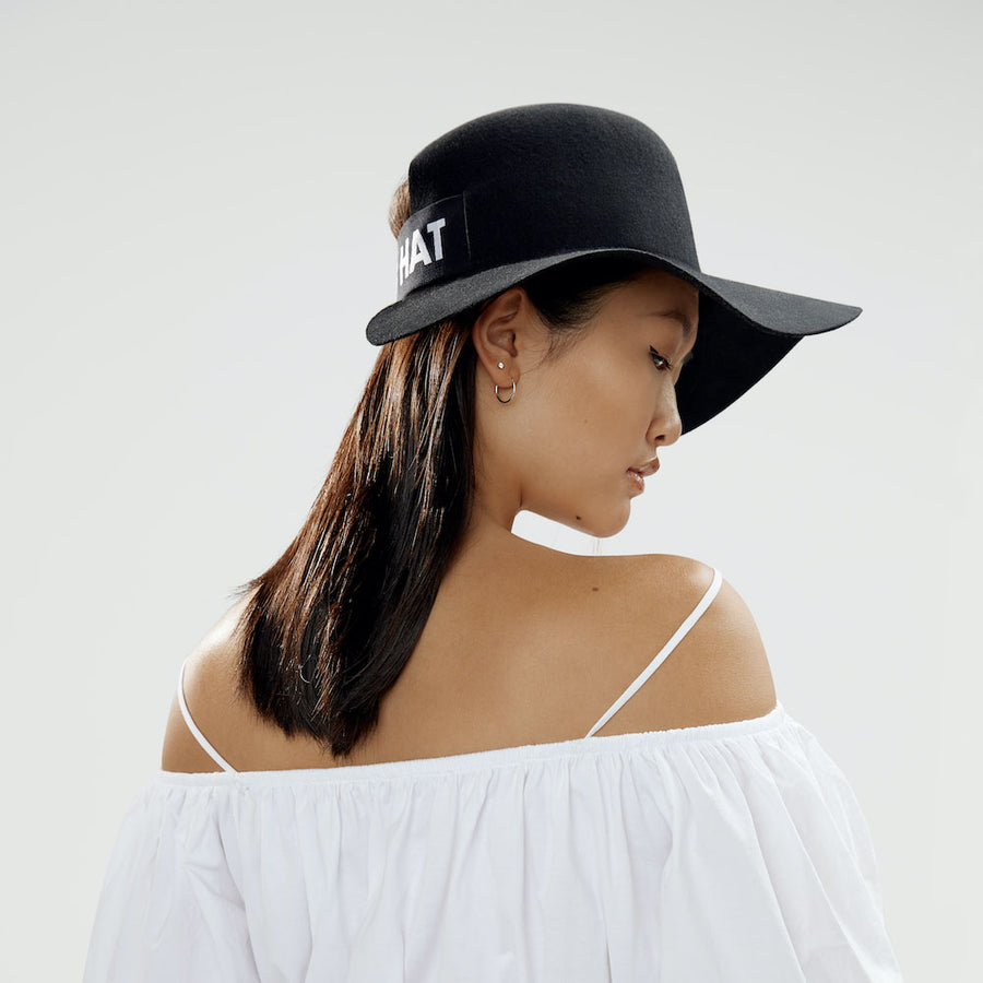 The model wear the Cropped Hat™ by Montreal designer Camille Côté.