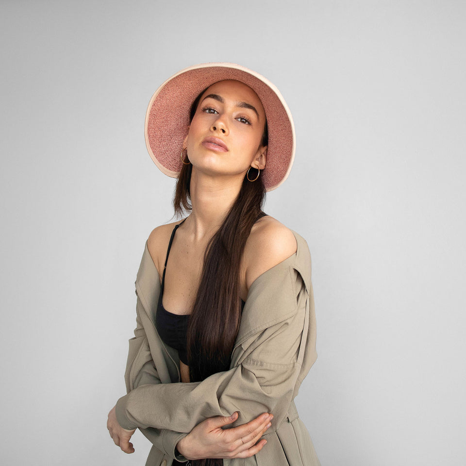The model wearing the pink wide brim hat BRIGITTE.