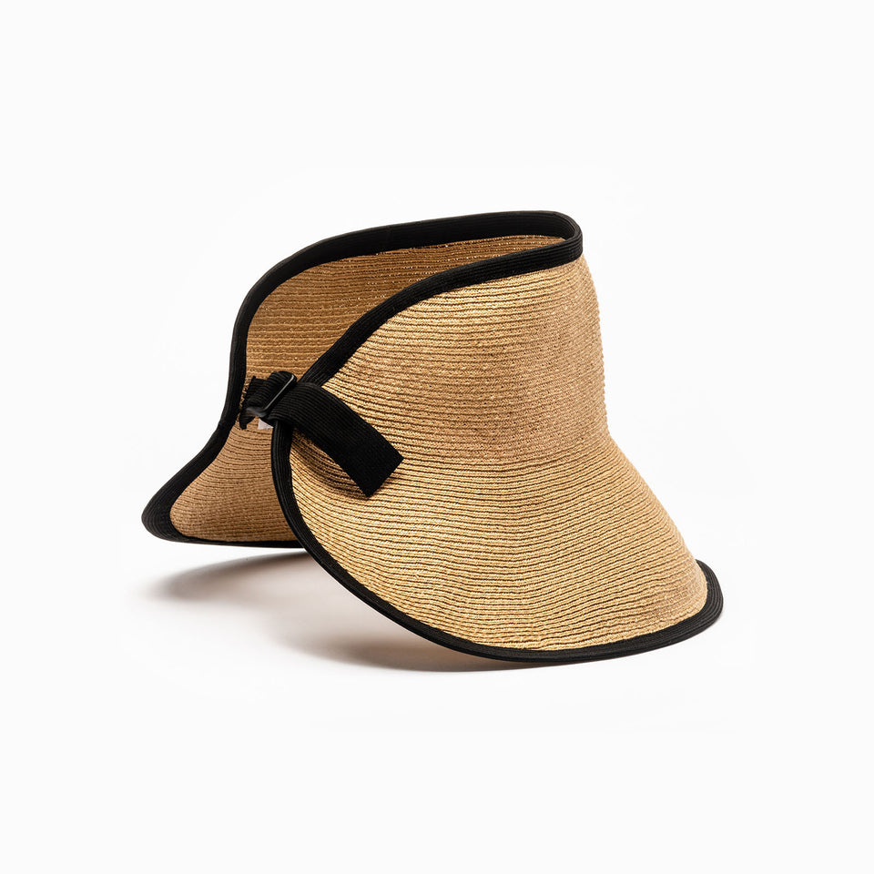 The summer straw visor brigitte available in tan color with black edge.