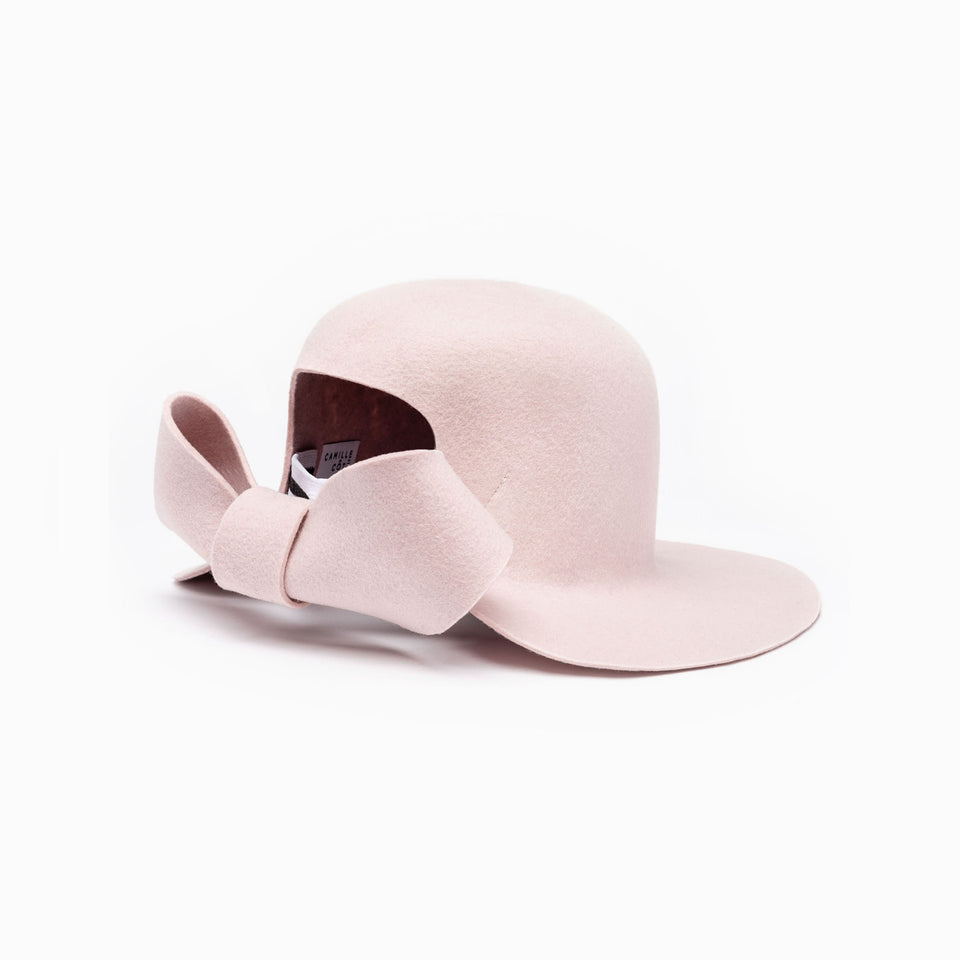 An oversized knot on the bronx hat pink.