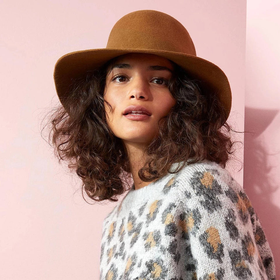 The curly hair model wear the Cabrera cinnamon felt Cropped Hat™.