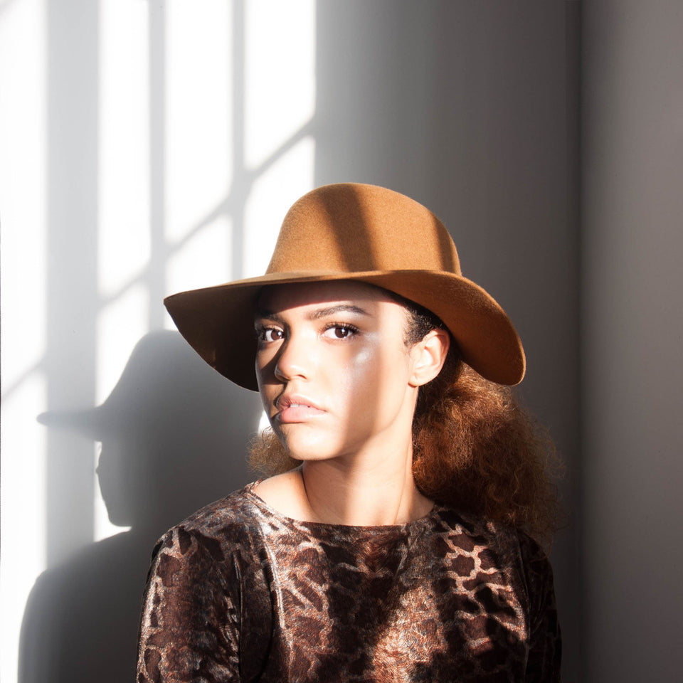 Cabrera Cropped Hat™ is designed by Camille Côté for natural hair.