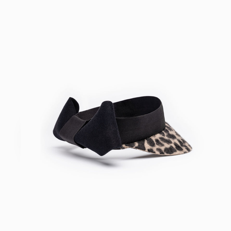 Leopard print visor designed with an elastic band and a oversized knot.