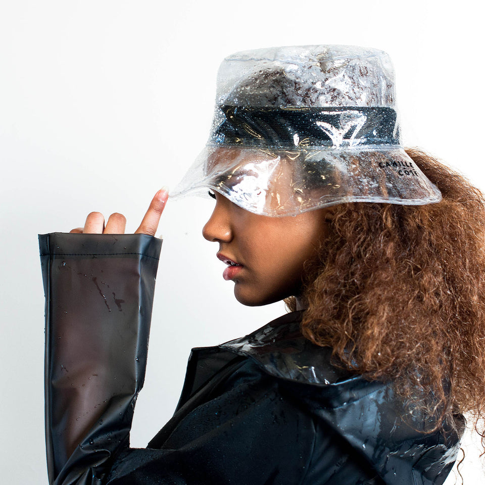 The rain hat, from Camille Côté's collection, fits the model natural hair.