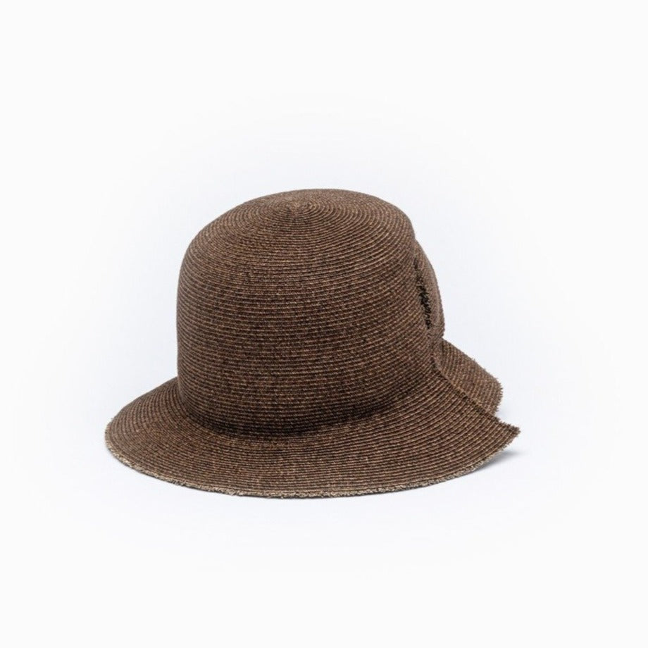 The front view of Camille Côté brown straw bucket hat DAVIS