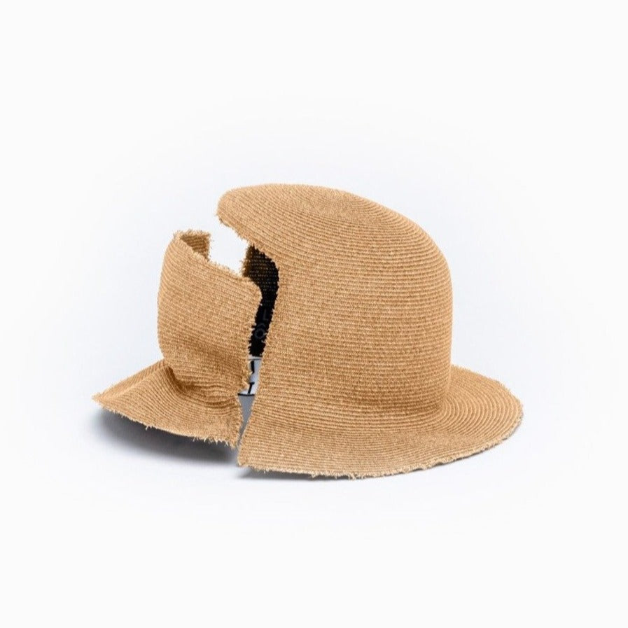 The tan straw bucket hat DAVIS viewed from the back