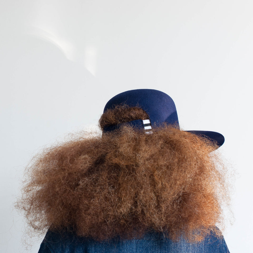 Afro hair model wears the Dean hat.