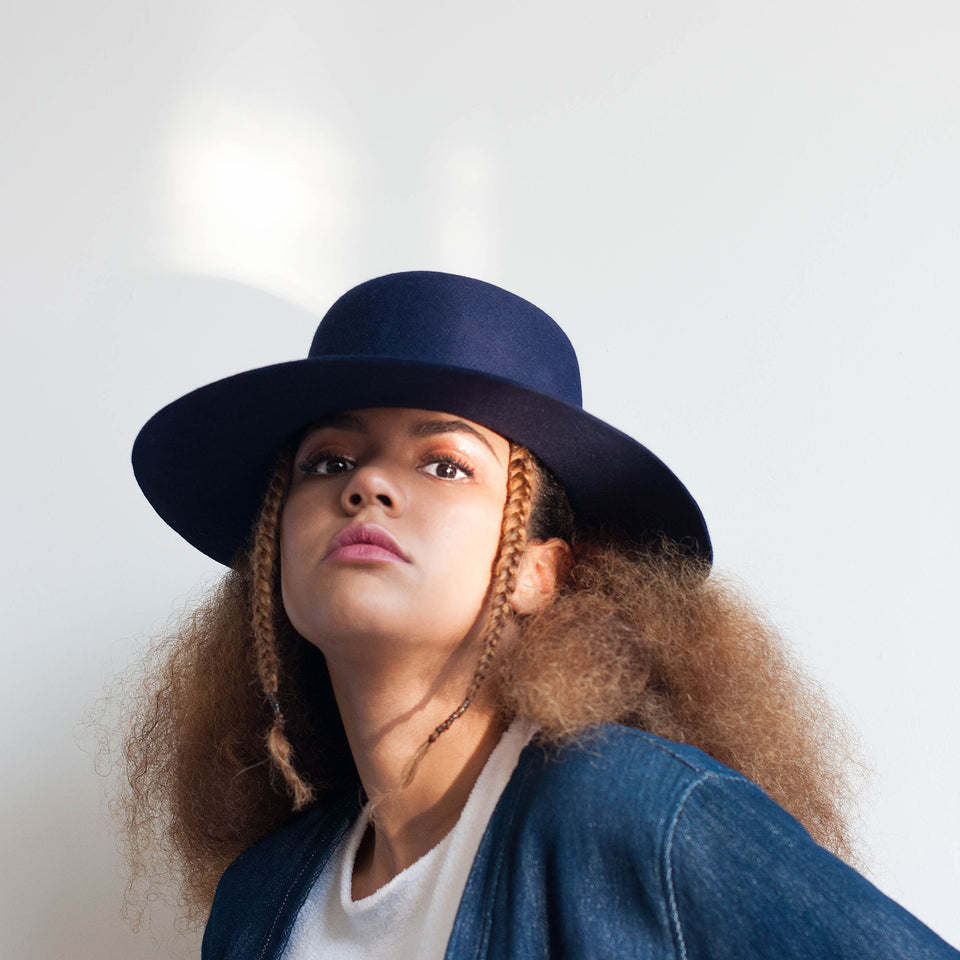 Natural hair model wearing the original Cropped Hat™ by Camille Côté.
