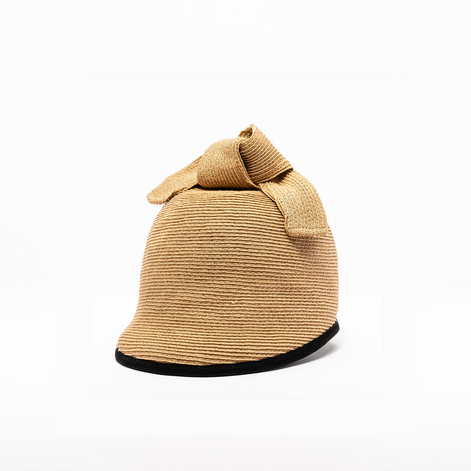 The Duchess summer straw cap is tan.
