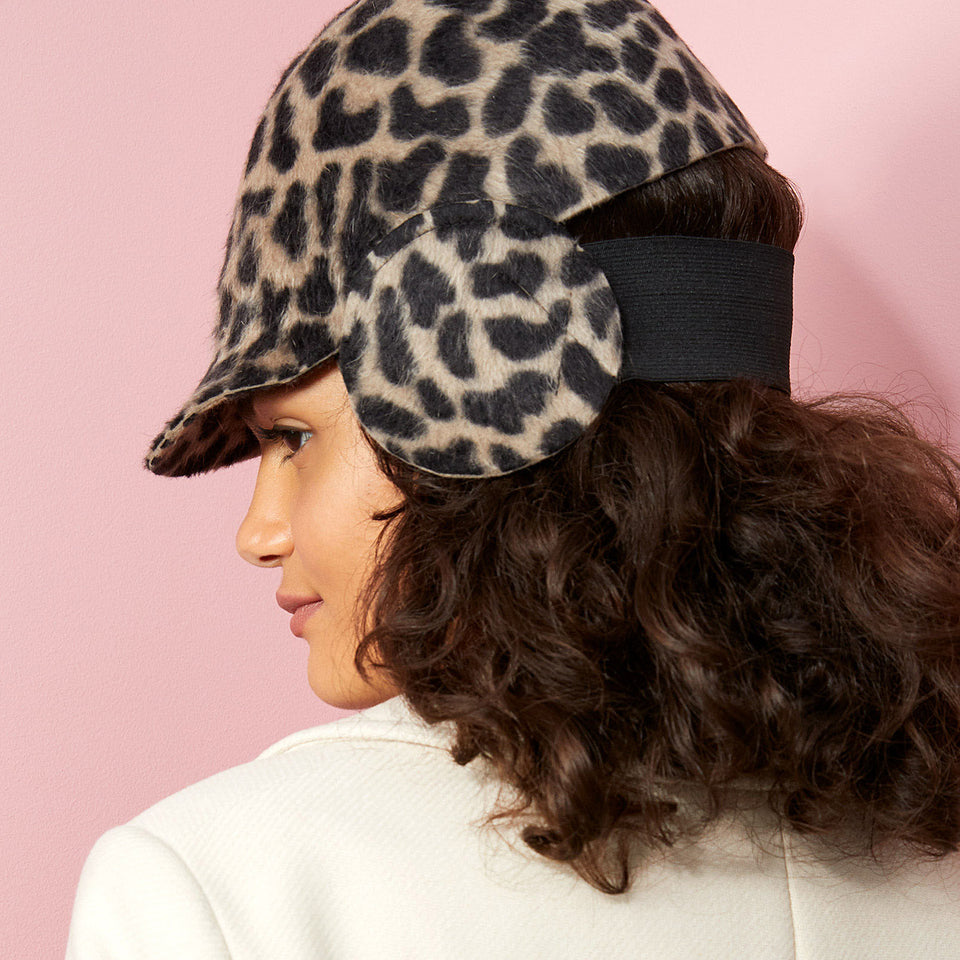 Earflap Cropped Cap™ Herman weared by the curly hair model.