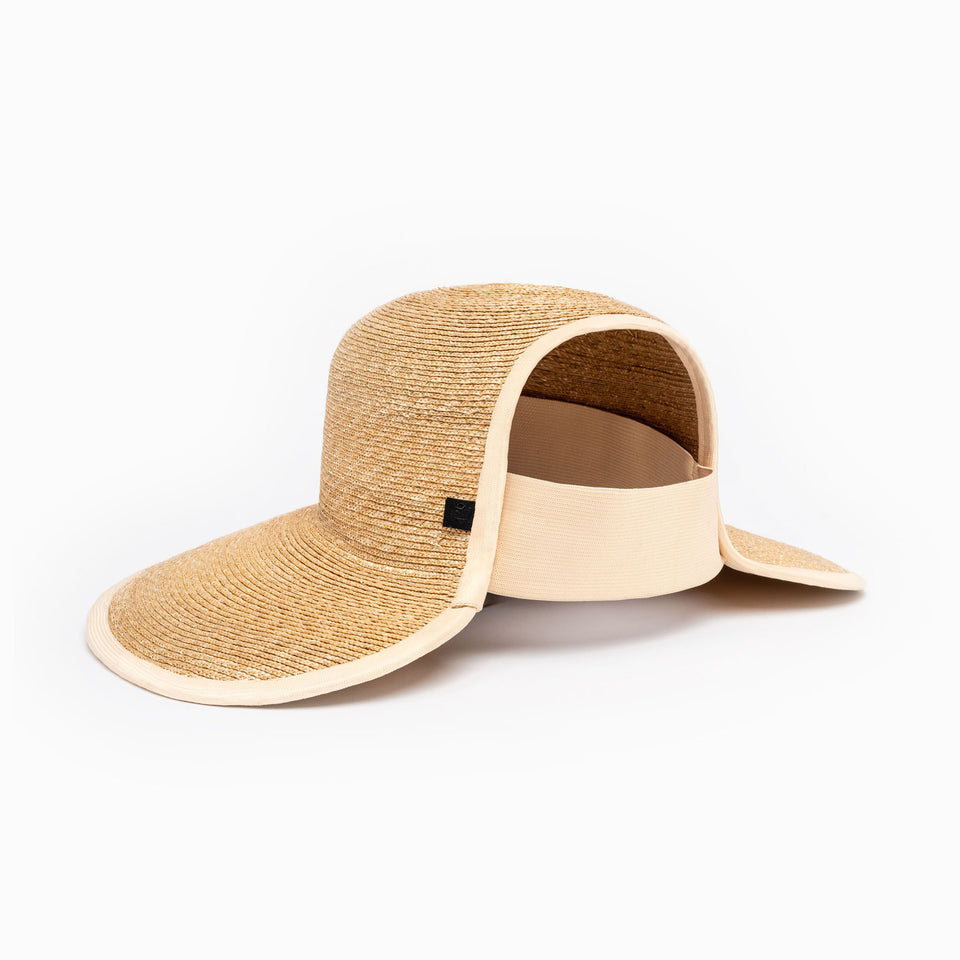 Camille Côté natural straw Copped Hat™ with an integrated elastic at the back.