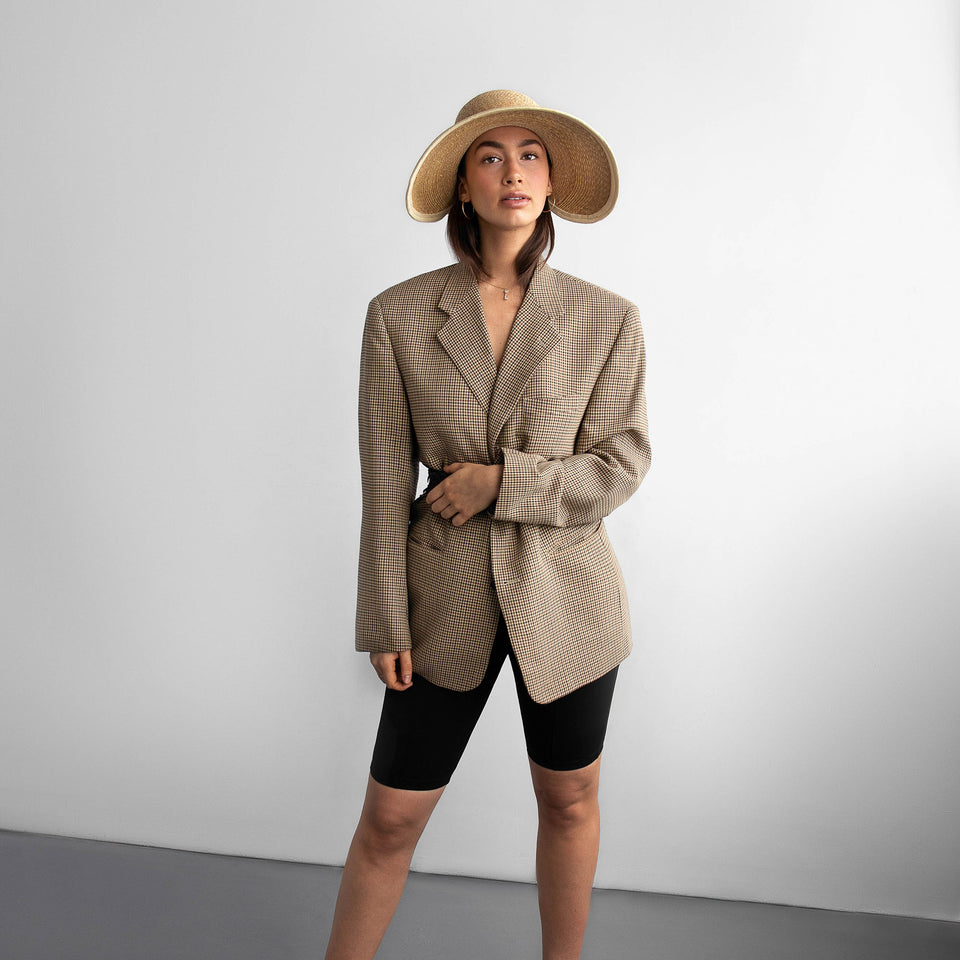 The model wearing her outfit with Jasime, the summer hat from SS19 collection.