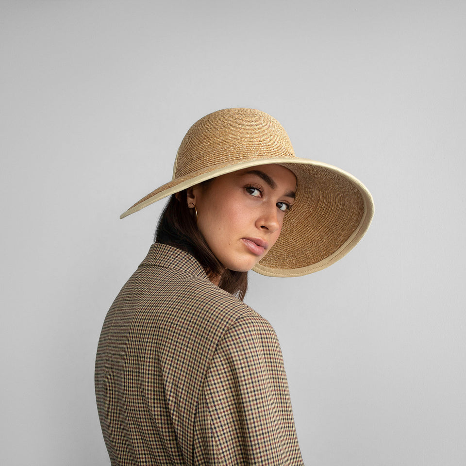 Model wearing Jasmine, the natural straw summer hat.