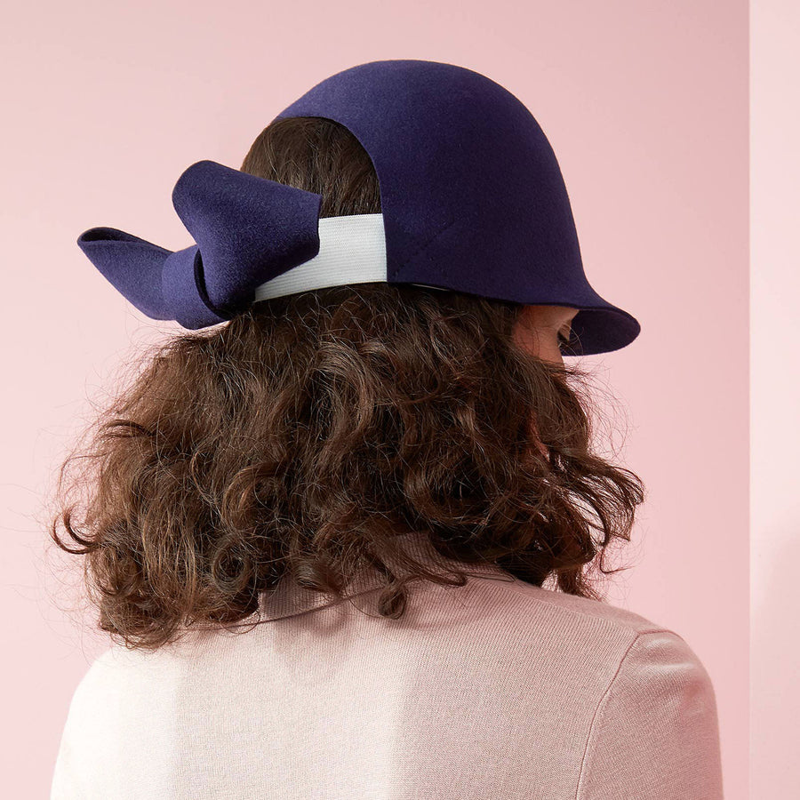The oversized knot on the Jeanne felt riding cap by Camille Côté.
