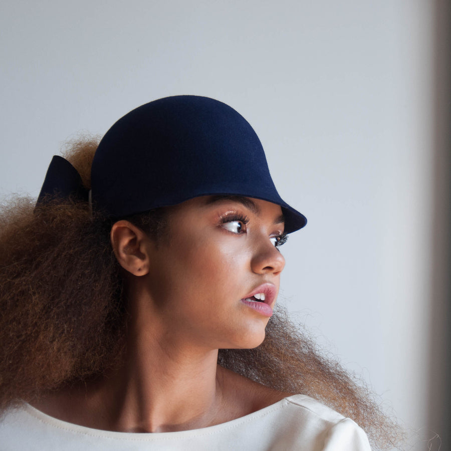 The Jeanne hat fits the natural afro hair of the model.