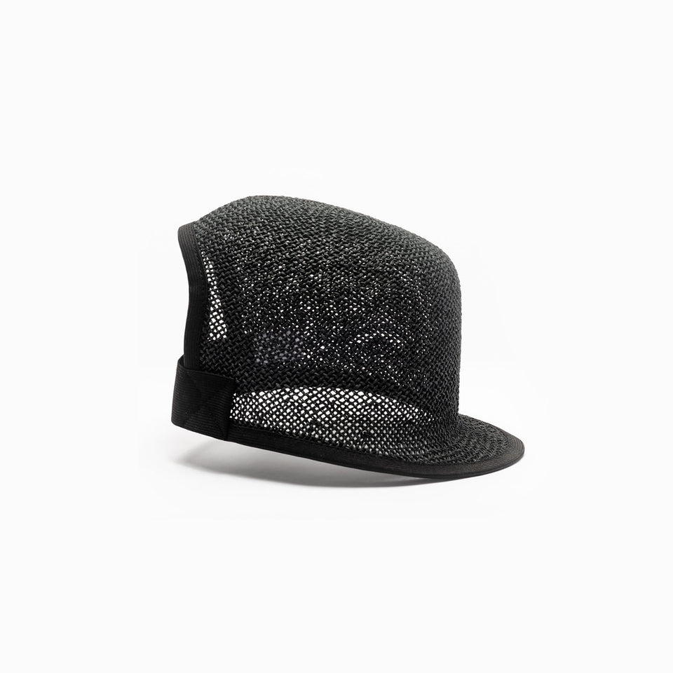 The side view of the Kennedy black straw hat.