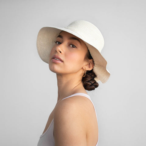 Our model is wearing the straw bucket hat Libertée.