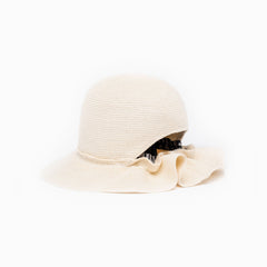 Back view of our straw bucket hat Libertée in Cream color.