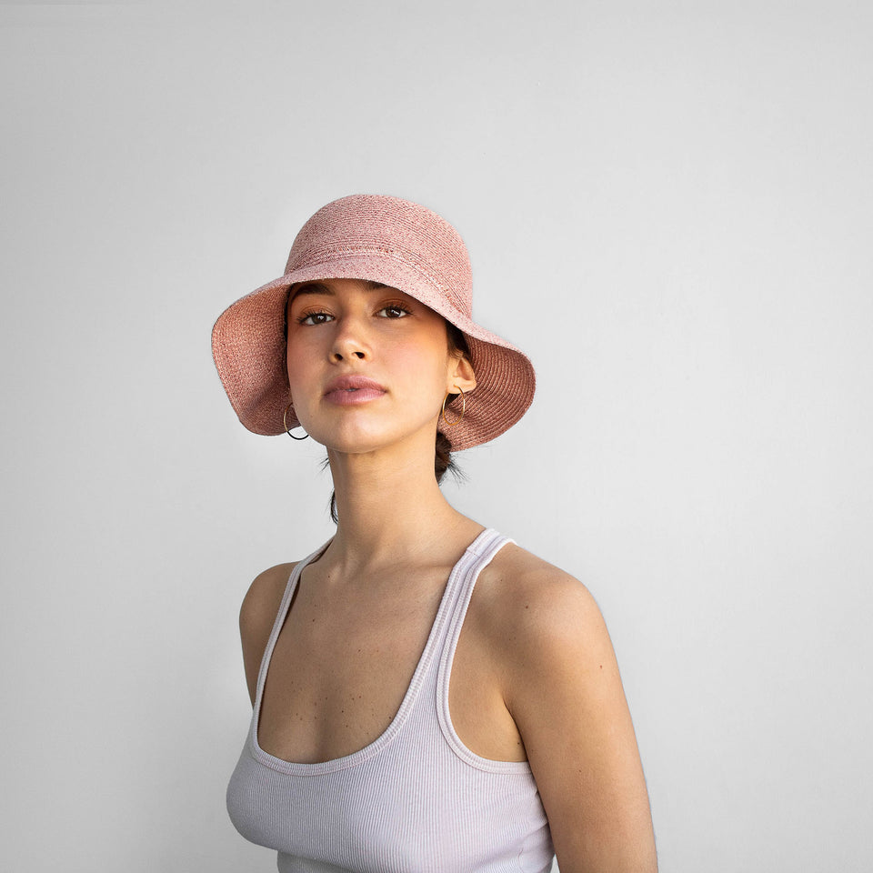 The model wearing the pink straw hat liberty by Camille Côté.