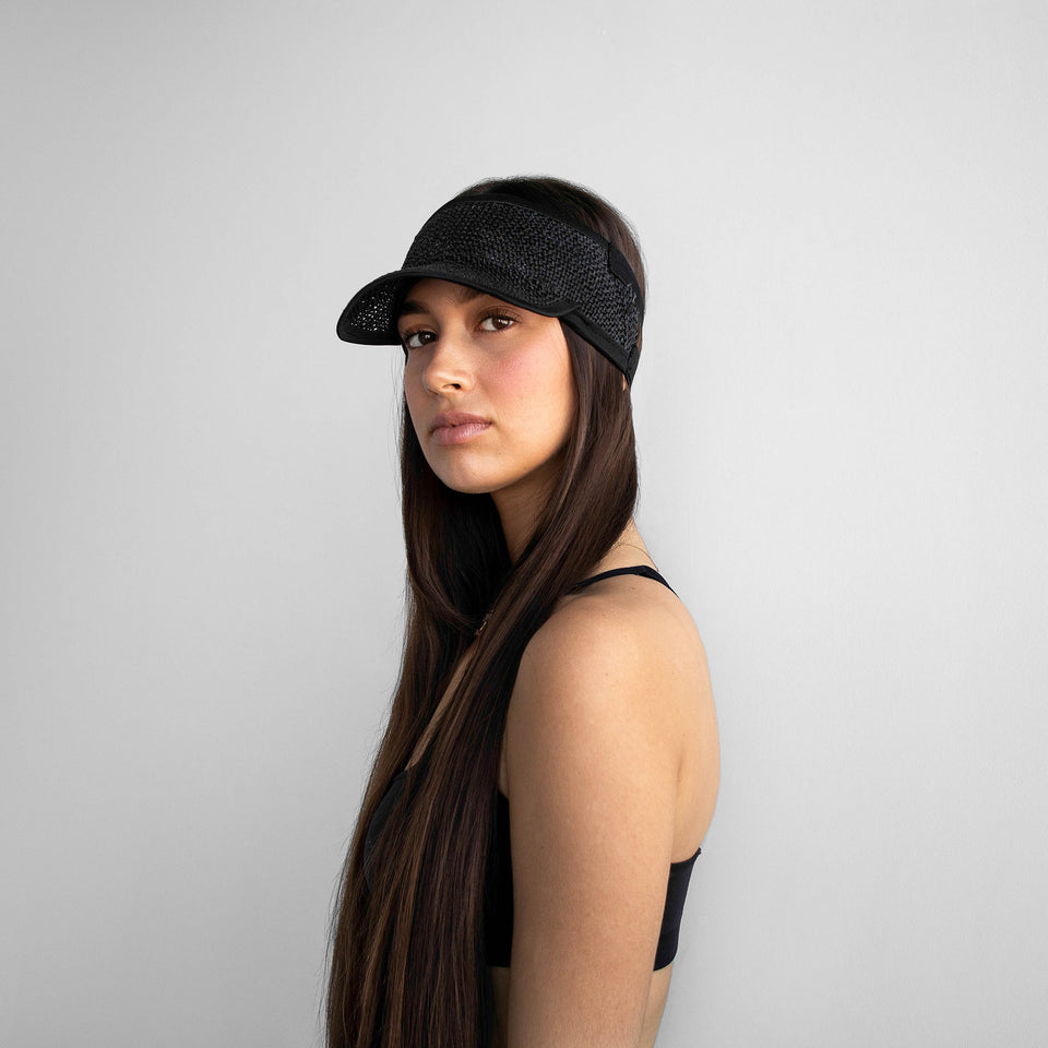The long hair model wears Marion black visor.