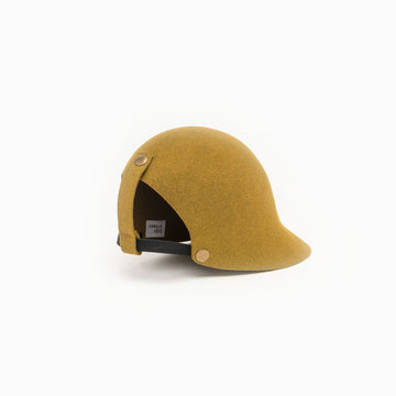 Cute snaps on this gold felt hat by Camille Côté