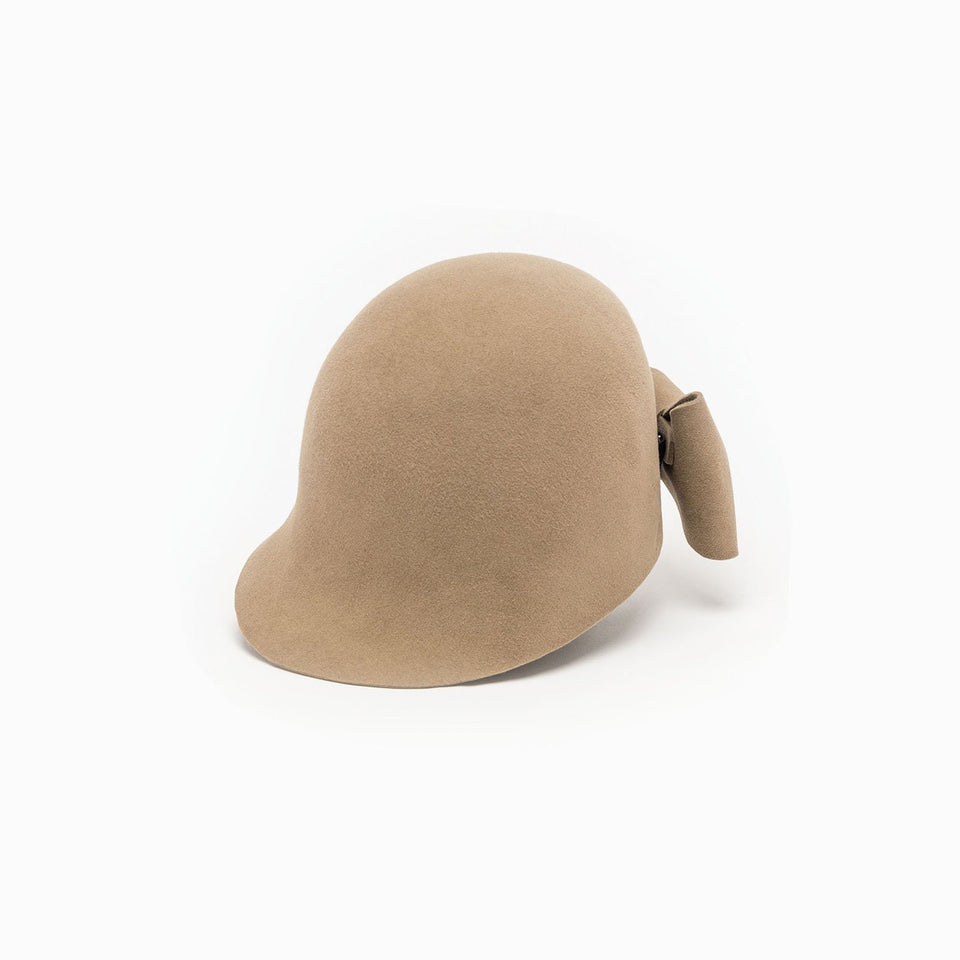 Jeanne is a felt cropped cap available in beige.